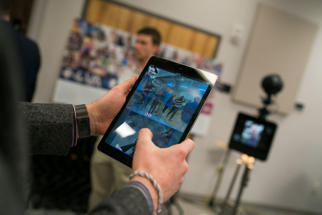 A tablet controlling a 360 degree camera on wheels