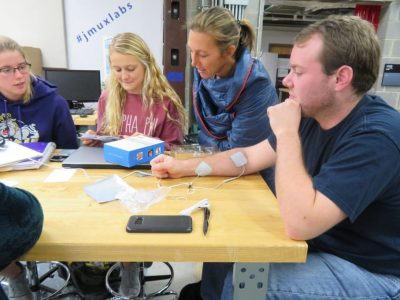 Students test a TENS machine.