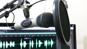 Microphone in front of audio equipment