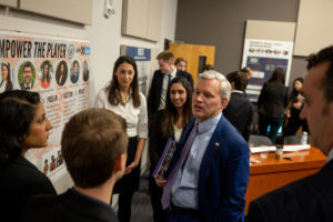 Students talking with President Alger about their project