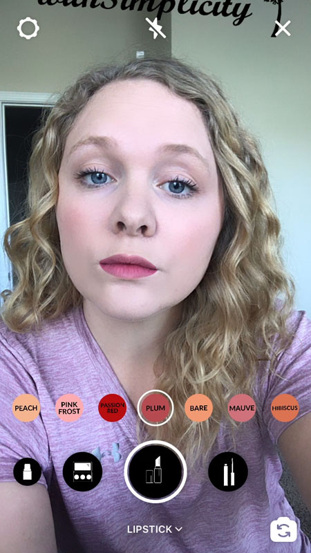A woman virtually tries on a lip color